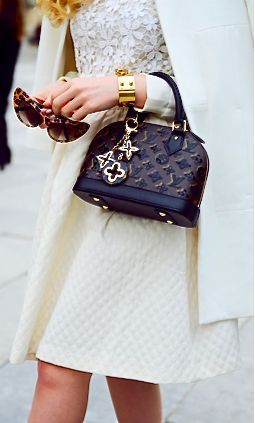 Another cool link is lgexotictransport.com  BAG / BRACELET : Louis Vuitton=Classy!