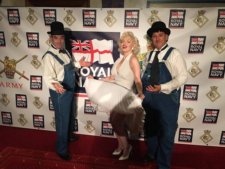 Laurel and Hardy Lookalikes posing for a photo with Marilyn Monroe lookalike and tribute artist Suzie Kennedy at the Summer Ball at The Wardroom, HMS Nelson, Portsmouth. Booked by Mike Sullivan Entertainments