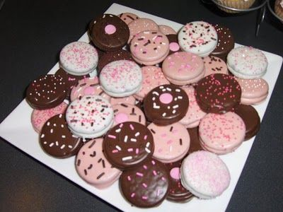 Chocolate dipped Oreos!! Doing these but with Valentine/heart sprinkles and on a stick!