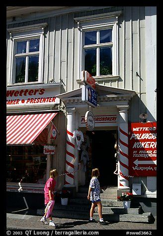 Kids in front of candy store in Granna. Gotaland, Sweden (color)