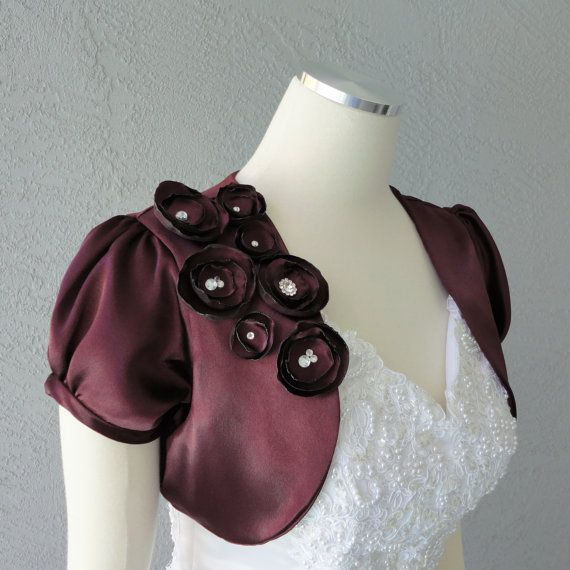 Wedding Bridal Aubergine Satin Bolero Shrug With Flowers and Rhinestones.  Getting in a darker purple.  http://www.etsy.com/listing/92855440/wedding-bridal-aubergine-satin-bolero?ref=usr_faveitems#