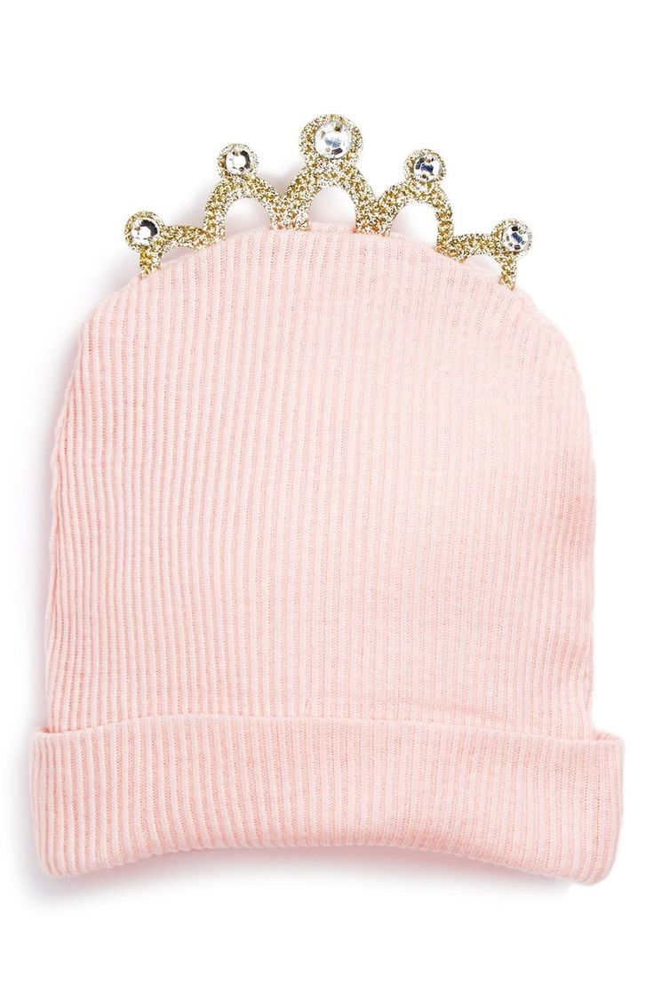 The little one will be cute as can be in this charming pink knit cap crowned by a sparkly tiara.