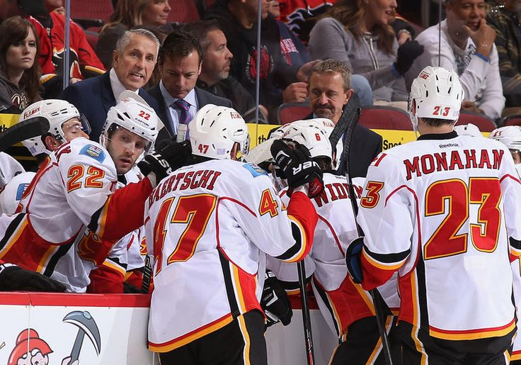 GLENDALE, AZ - OCTOBER 22: Head coach Bob Hartley of the Calgary Flames talks with his team during a timeout from the third period of the NHL game against the Phoenix Coyotes at Jobing.com Arena on October 22, 2013 in Glendale, Arizona.