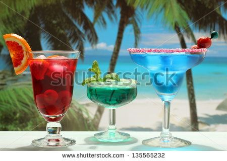 colorful cocktails three glass on the beach by Denio Rigacci