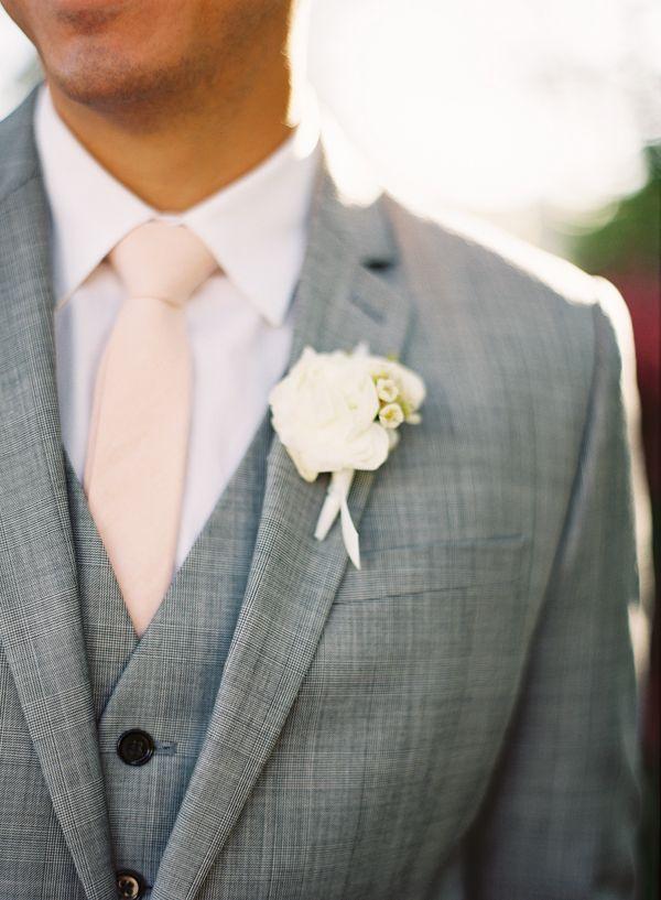 Peach tie, white bout, grey suit