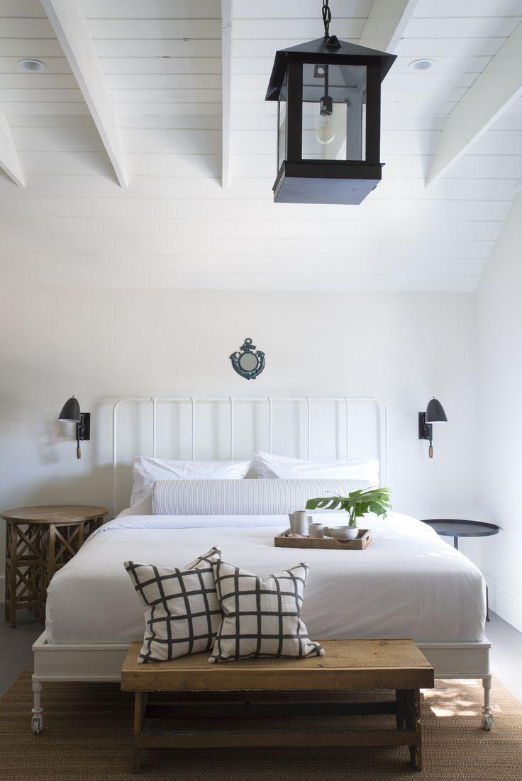 Modern bedroom design with white wooden ceilings beam | BHDM Design