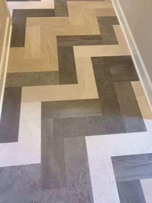 Tile styles continue to evolve, including this fun-patterned herringbone in a mudroom. (#30 Custom One Homes, Woodbury)