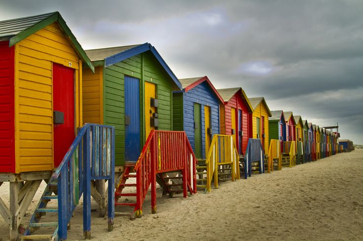 It can look like Australia but it is really in Cape Town, South Africa. These colorful beach huts are located in Muizenberg, one of the most beautiful place around Cape Town. A perfect place to start surfing!