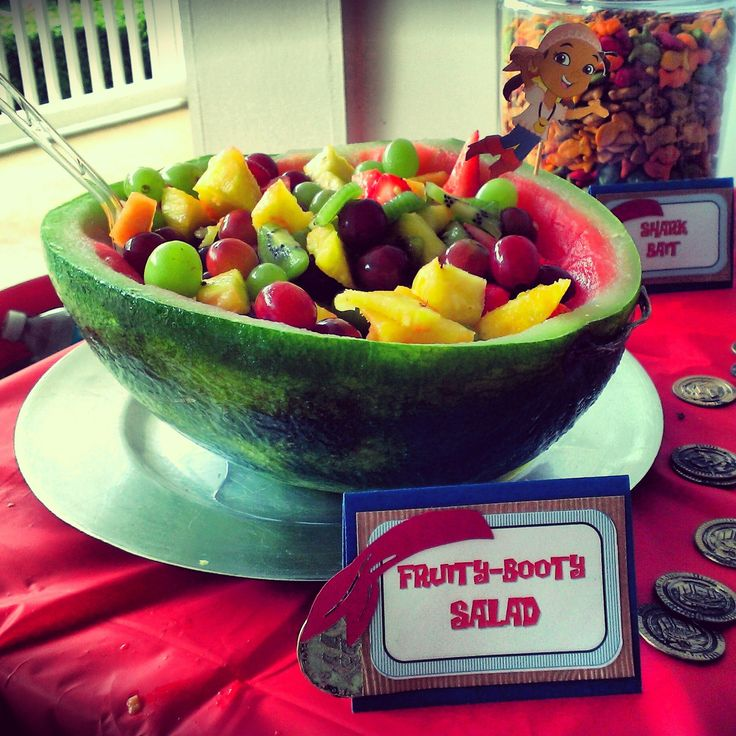 DIY Carved watermelon bowl, carve and freeze overnight / Custom Jake and the Neverland Pirates Birthday Party food labels via DivaDecorations / Pirate party food #fruitbowl #summer #summerparty #partyfood #watermelon