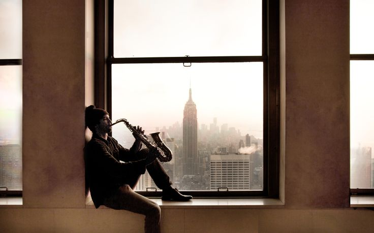 United States New York City Top Of Therock Saxophone Player