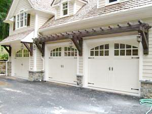 Trellis above doors with lamps hanging from braces