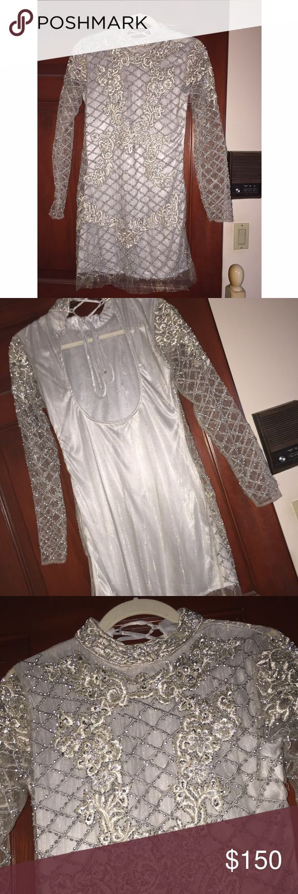 Silver long sleeve formal gown Absolutely STUNNING dress. I've never gotten so many compliments. Silver/grey color, bead work is gorgeous. Criss cross neck tie. Open back. Size 6. Warn once, no flaws. Dresses Long Sleeve