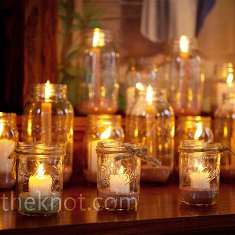 The altar was covered with rows of Mason jars filled with candles of varying heights. Inside the jars, sand kept the candles standing straight.