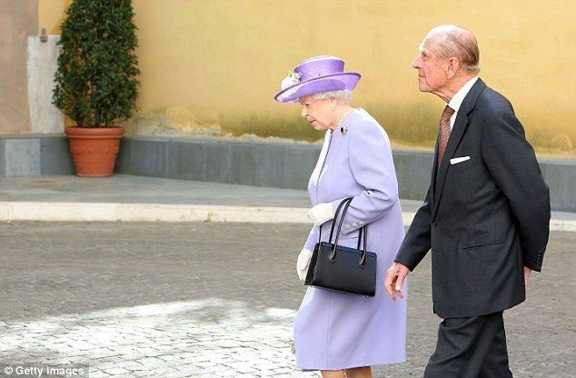 4/3/14.   Royal presence: The Queen and Prince Philip arrive at the Paul VI Hall for the meeting with Pope Francis