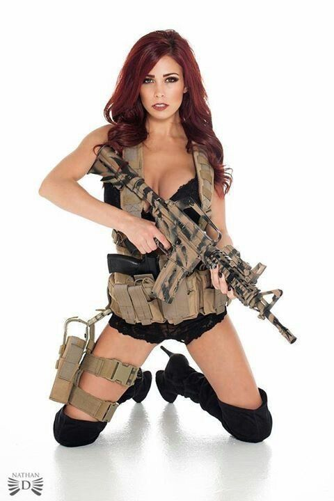 Hot Redhead With Her Weapon