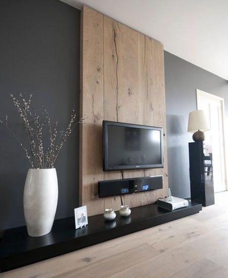 Un salón sencillo. Para no cargar el interior de esta casa se han elegido pocos muebles y una pequeña selección de artículos decorativos. http://www.originalhouse.info/catalogo/interiores/