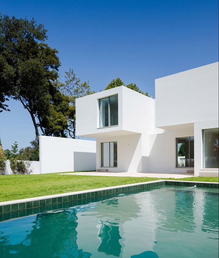Each room in this Porto house by 236 Arquitectos is contained within an individual white box