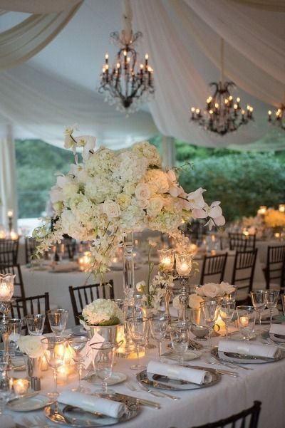 Traditional wedding table decor: http://www.stylemepretty.com/michigan-weddings/2014/05/15/classic-tented-estate-wedding/ | Photography: Laurie Bailey - http://lauriebailey.com/