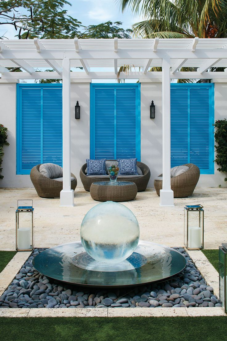 Designed For Island Entertaining, This Chic Bahamian Courtyard Home Is A Showstopper And A Conversation Starter
