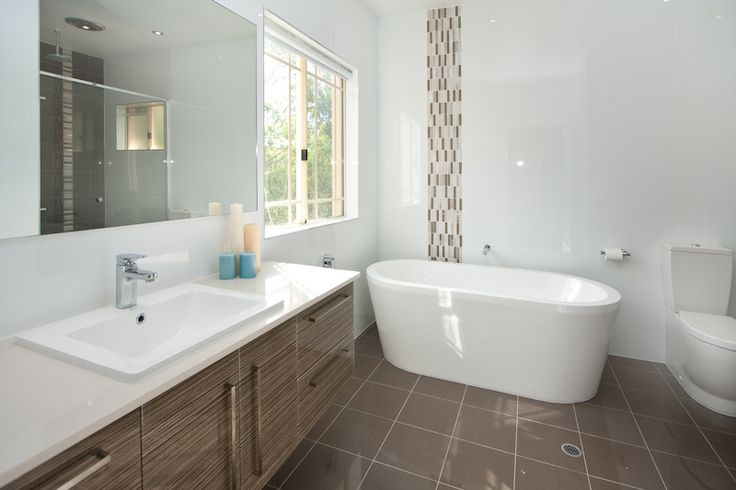 A free-standing bath can create a sense of space in your bathroom. www.onecallkitchens.com.au