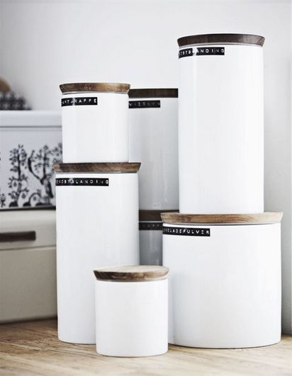 burkar... Love these mod white canisters with wooden lids!