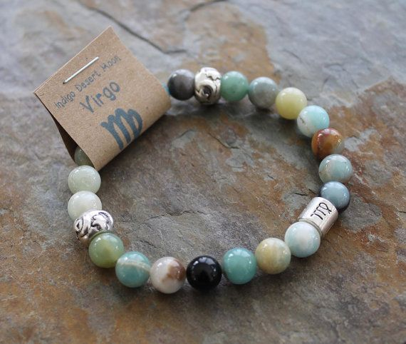Virgo ♍ Amazonite Bracelet. Amazonite named for the Amazon River it brings a little water energy to this earth sign helping them to be calm and balanced. Not your sign? Consider your rising or moon sign ❤ or stack all three! You can see all of the others in picture #5. This Amazonite bracelet is made with 8 mm beads a Virgo zodiac glyph and 2 crescent moon and stars beads, it measures approximately 7 inches it should fit almost any wrist. I use extremely strong latex free elastic cord and…
