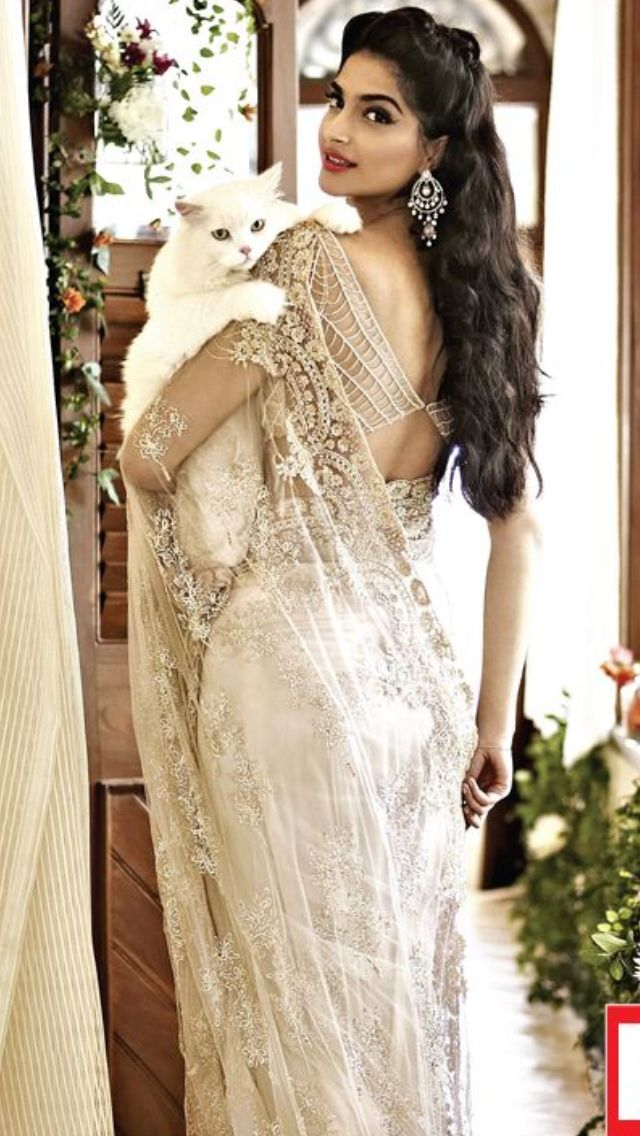 I like this dress....MAYBE...but I can do without the cat. Lol. Sonam Kapoor #Bollywood #Fashion Bollywood fashion, bollywood celebrities, #indianweddingsmag