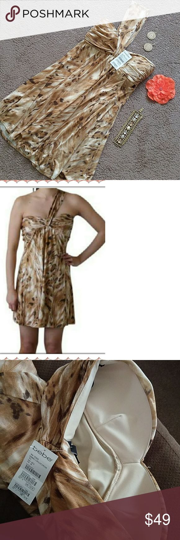 NWT BEBE ONE SHOULDER ANIMAL PRINT SEXY DRESS 🔥🔥 Brand new with $129.00 tag still attached. Strap can be worn on either side since it is attached in the middle. Completely lined. All neutral colors such as tan, beige, brown etc. Great dress for going out on a summer night! bebe Dresses Mini