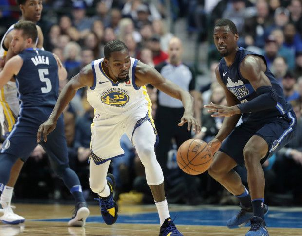 Golden State Warriors forward Kevin Durant (35) and Dallas Mavericks forward Harrison Barnes (40) chase the ball during the second half of an NBA basketball game in Dallas, Wednesday, Jan. 3, 2018. (AP Photo/LM Otero)