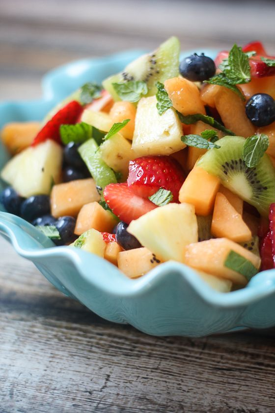 Best Ever Boozy Fruit Salad - the fruit is soaked in lemon liquor! So easy and impressive to bring to brunch.