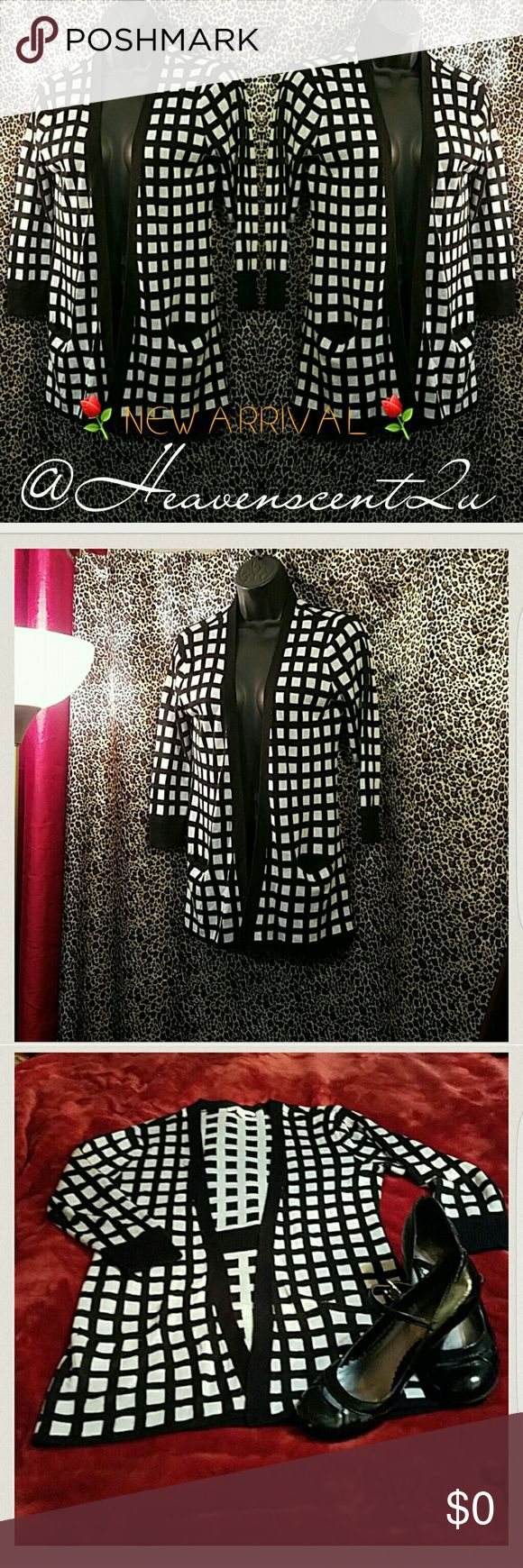 CHECK✔ Sale price firm!  Look like a queen in a sweater that harkens back to the classic board game.   Thanks for stopping by my Posh Closet  Please come again soon  Ciao New York & Company Sweaters Cardigans
