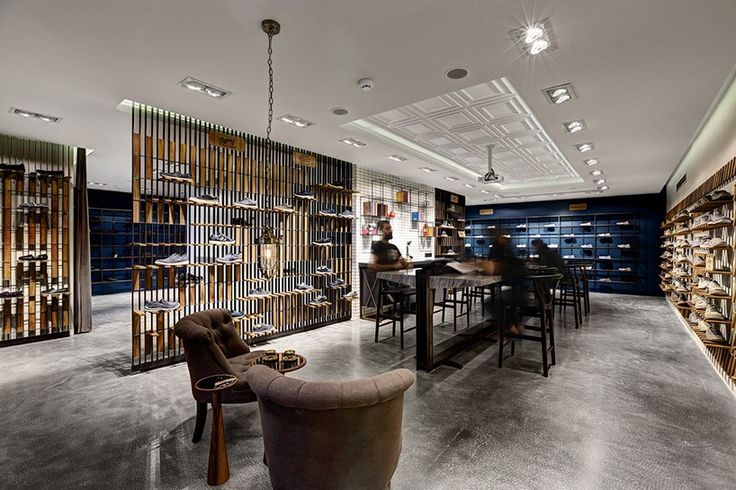 this retail interior by zemberek design includes a modular and dynamic shelf system for presenting skechers footwear.