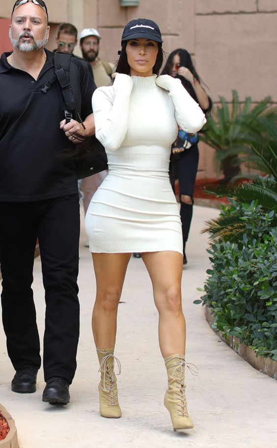 White-hot!  The TV personality shows off her famous curves while leaving the Atlantis hotel in Dubai.