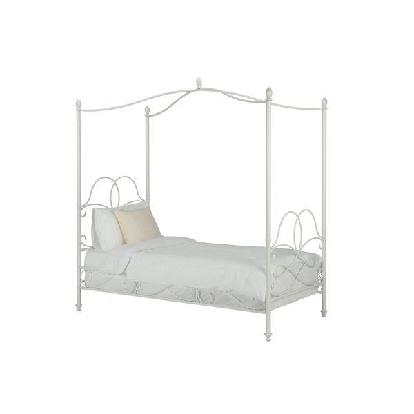 Sleep like royalty with this Dianna twin canopy bed, complete with intricate scroll work patterns and finial detail at the top of each post. Requires a mattress foundation or box spring (sold separately).