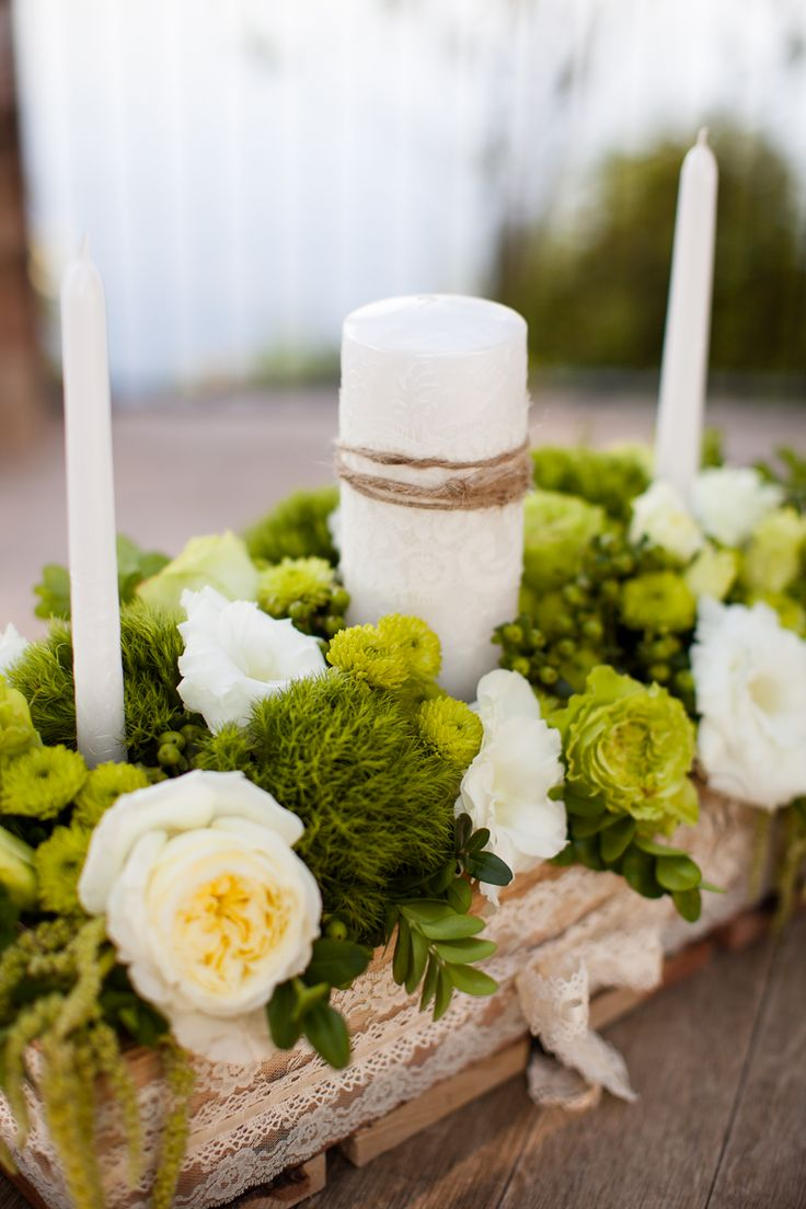 Unity candle moved to head table as centerpiece for bride and groom