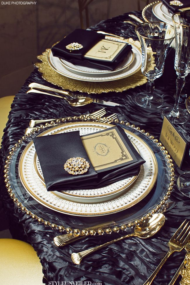 Wow. Love the rich colors and the formal dinner plates and mix and match chargers. The gold brooch is an extra elegant surprise!
