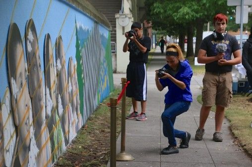 Documenting the completed mural.