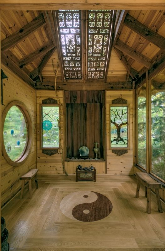 Meditation room. Nice stained glass sky lights, different shaped windows lots of wood, just replace the yin-yang for a pentacle and we're all set.