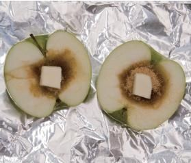 Baked Apple for camping! Halve an apple. Hollow out the core and fill with brown sugar, cinnamon, granola and a pat of butter. Wrap in tin foil and place in the coals.