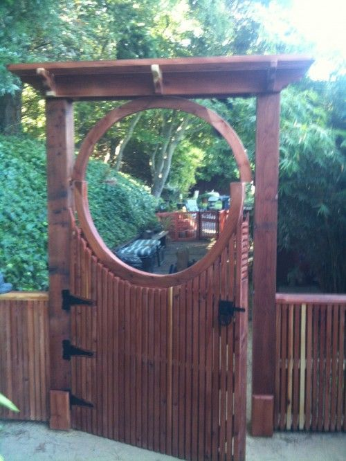 Asian inspired gate. The rest of fence should be higher for security reasons