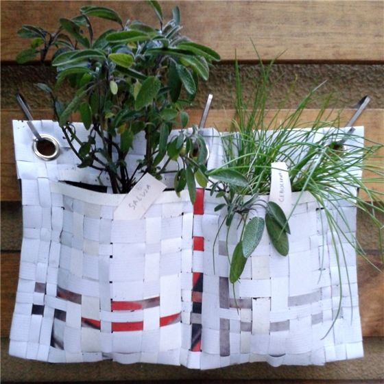 This great hanging herb planter is made from recycled advertising signs. Each 1 litre pocket can be filled with earth allowing you to grow plants  ...