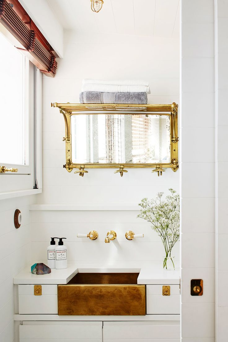 brass and white reign in the bathroom of this chic and tiny home on the italian riviera | house tour on coco kelley