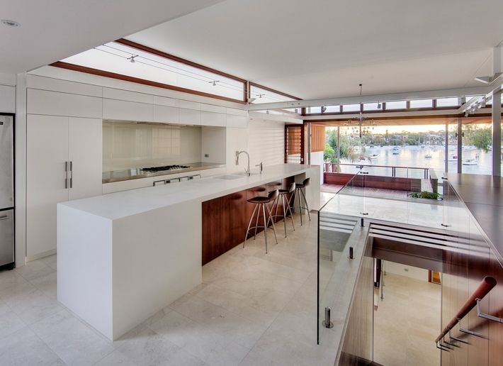 CplusC - Sydney Architects and Builders. Tennyson Point Kitchen. Australian Jarrah veneer, Corian. #Sydney #Sydney architects #Kitchen