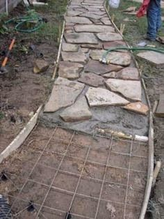 flagstone path w concrete. you can skip the grid & concrete, my path is set directly into Idaho's farmland clay soil!