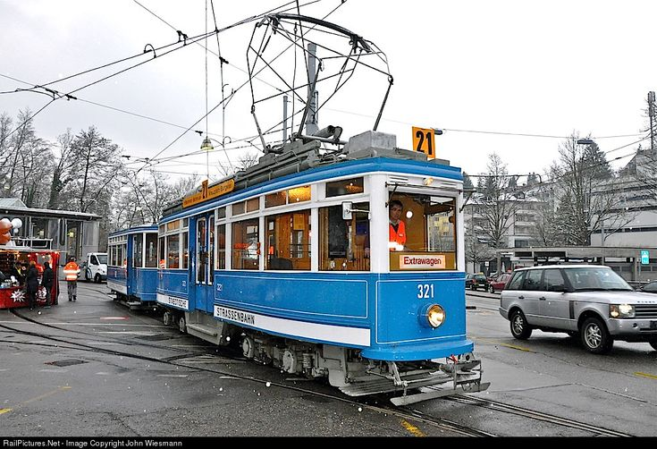 Historic Ce 4/4, called Elephant, leaves the area of the Tram muesum Zurich for a trip through the city. It's a pretty cold winter day with beginning snow fall. Between 1929 an 1931, the StStZ (now VBZ) bought 50 of the Ce 4/4. They got the nickname Elephant because of their heavy weight and power for that time. Note also the special formed pantograph, looking like a deer antlers.