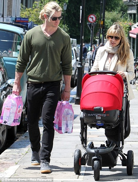 Savouring every moment: Chris was seen in London with his wife Elsa Pataky and baby India just yesterday