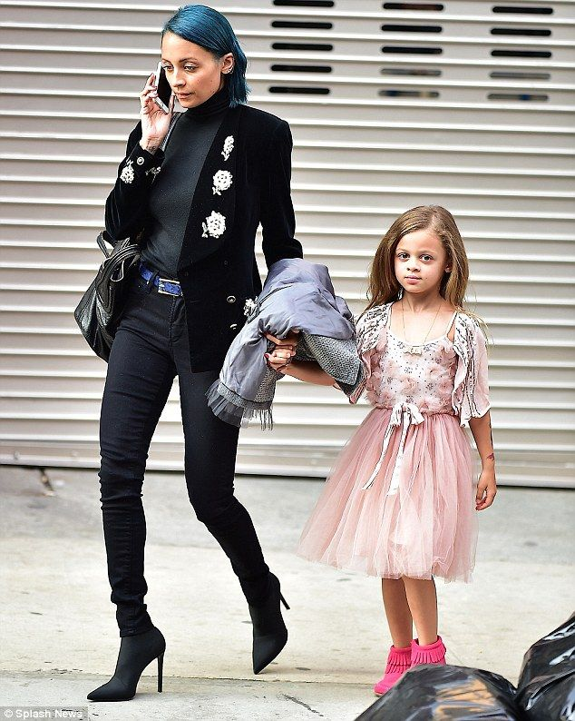 Hand-in-hand: The TV personality and fashion designer chatted away on her phone while six-year-old Harlow looked adorable in head-to-toe pink