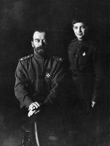 "A ""dark"" portrait of Nicholas and Alexei, 1914.  Love Alexei's little smile."