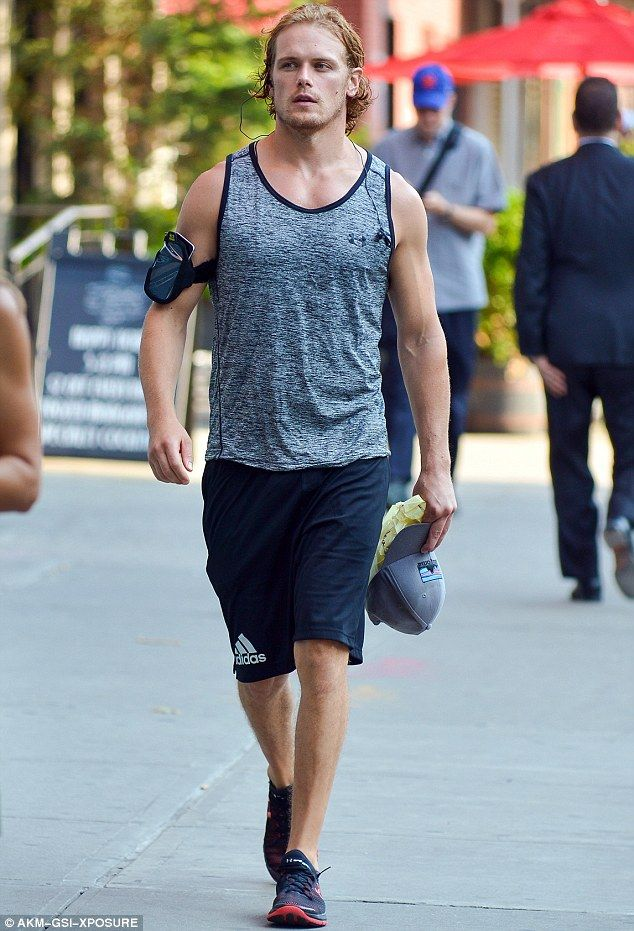 Someone's been eating their porridge: Scots Outlander hunk Sam Heughan showed off his muscles in a tight vest after a trip to the gym in New York on Wednesday