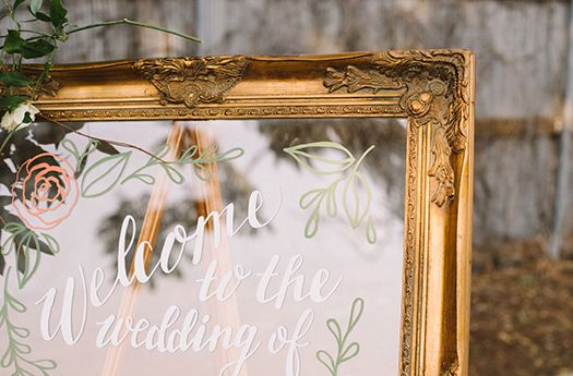 Hand Lettered Signage - welcome sign, menus, table numbers for a romantic wedding at Blanc Denver including a detailed seating chart on glass pane doors